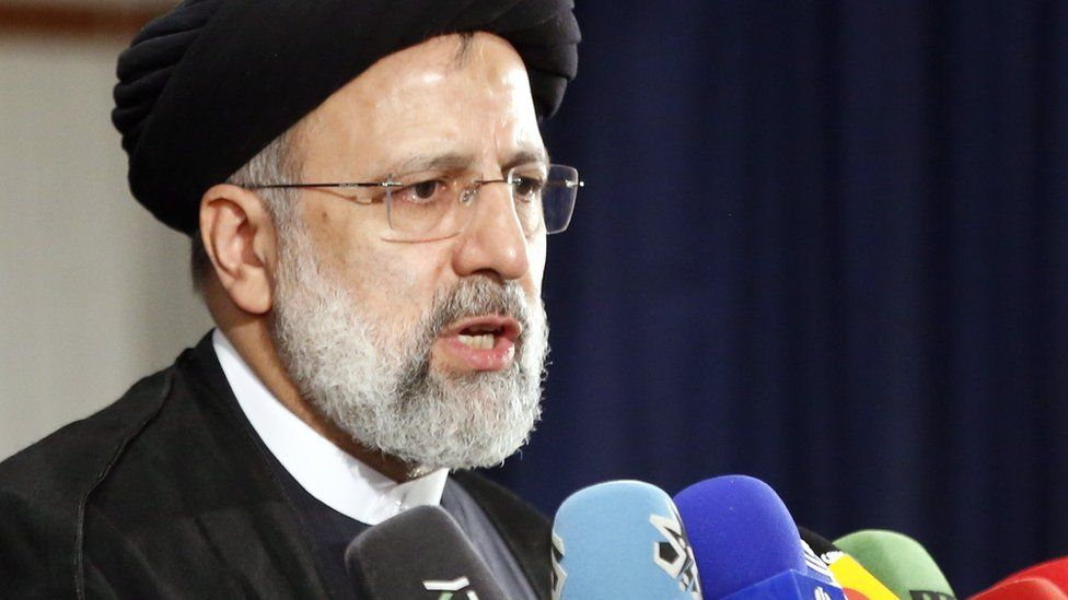Iran's judiciary chief Ebrahim Raisi speaks to reporters after registering as a candidate for the 2021 presidential election (15 May 2021)