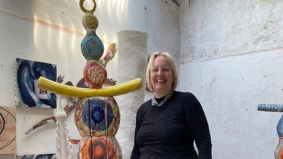 Artist Sandy Brown alongside Earth Goddess, which is currently work in progress