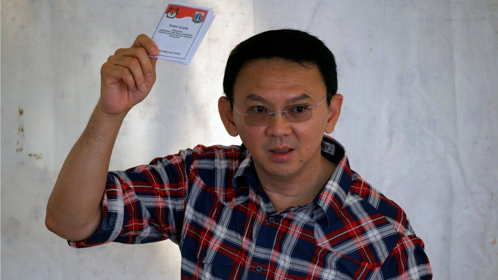 Governor of Indonesia's capital Basuki Tjahaja Purnama shows his ballot during an election for Jakarta's governor in Jakarta