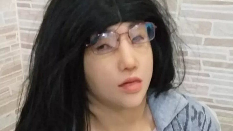 Photo released by the Rio de Janeiro state prison authorities of Clauvino da Silva disguised as his daughter
