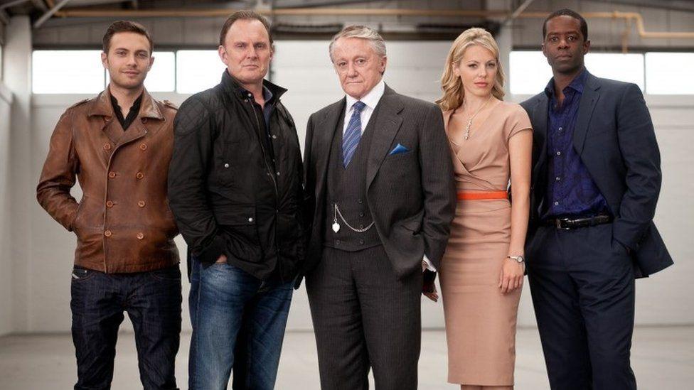 Robert Vaughn and the cast of Hustle