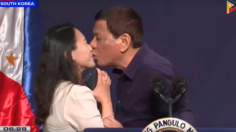 Screenshot of Duterte kissing OFW