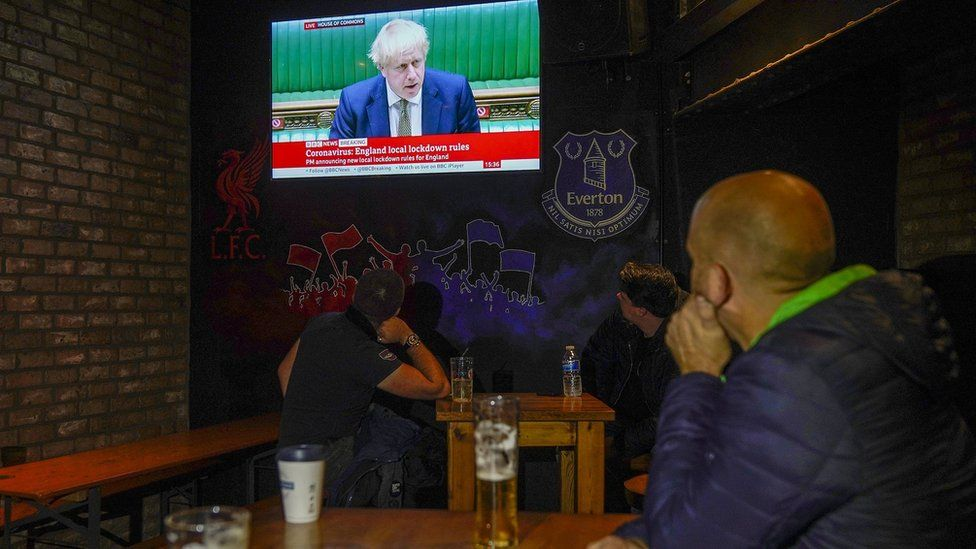 People watch the PM in a pub in Liverpool
