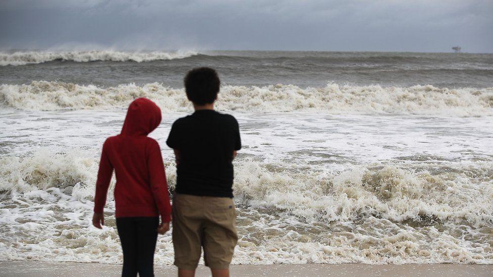 Waves crash on a beach at Dauphin Island, Alabama. 4 Sept 2018