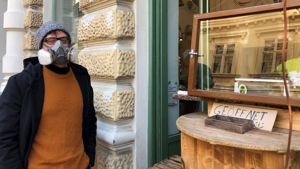 Robert stands outside cheese shop