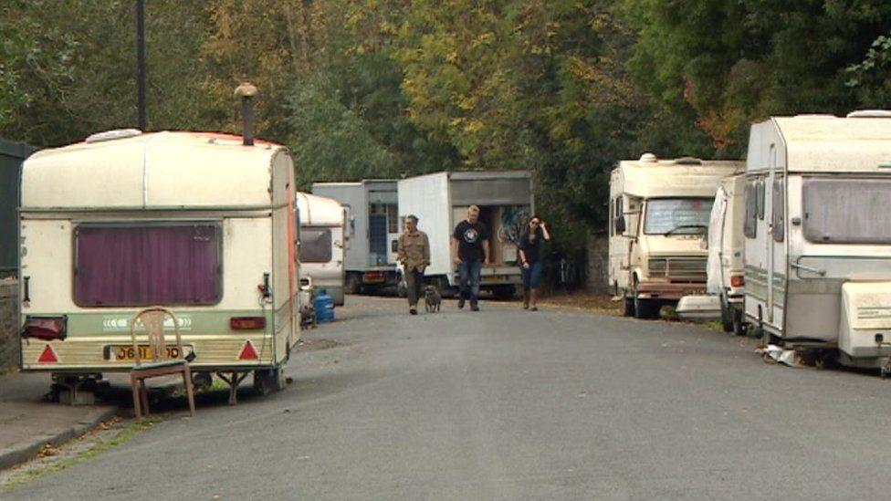 Caravans and vans parked on road