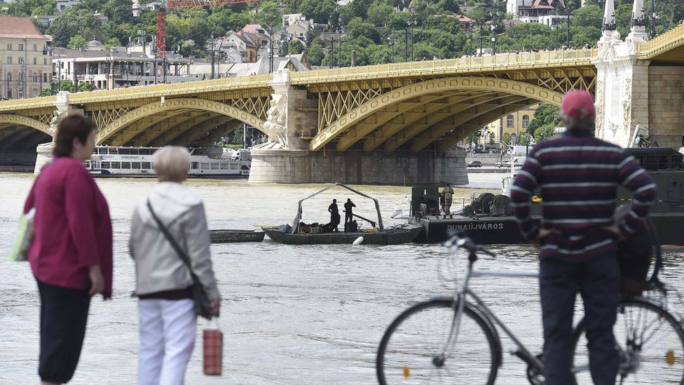 Rescuers search for bodies and survivors of the Danube tour boat accident in Budapest