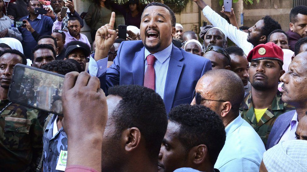 Jawar Mohammed (C), a member of the Oromo ethnic group who has been a public critic of Abiy, addresses supporters that had gathered outside his home in the Ethiopian capital, Addis Ababa after he accused security forces of trying to orchestrate an attack against him October 24, 2019