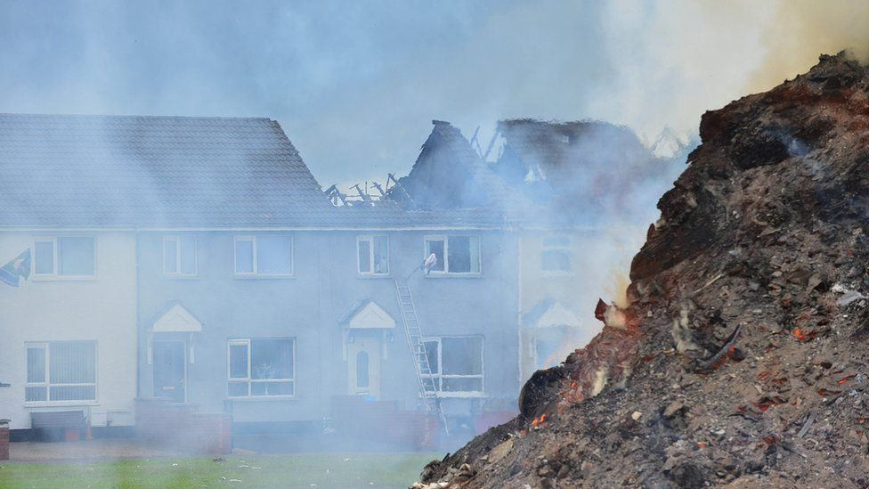Fire-damaged houses at Hopewell Square in Belfast's Shankill area