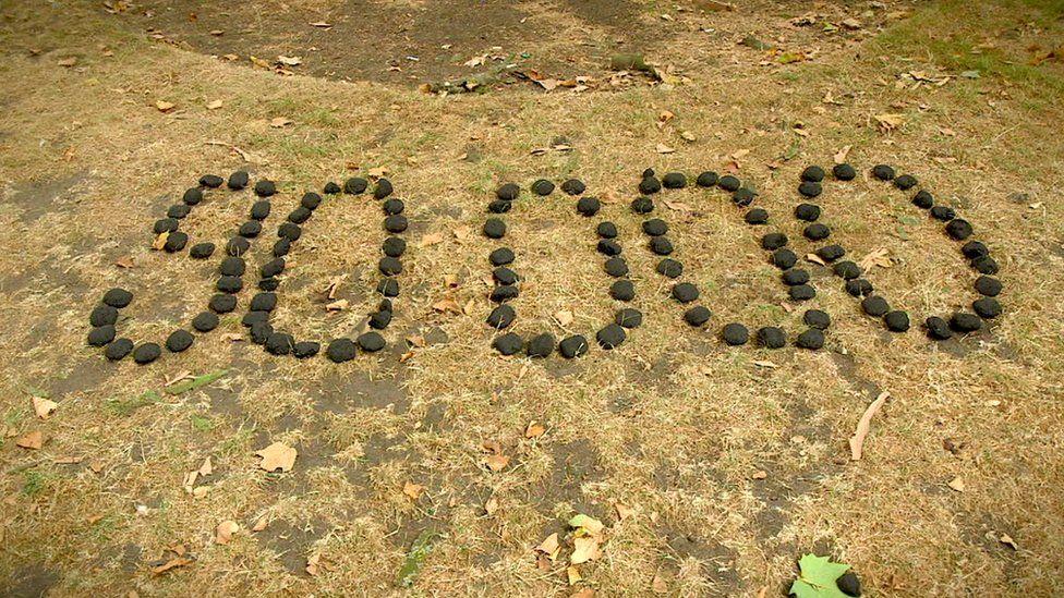90,000 written in charcoal