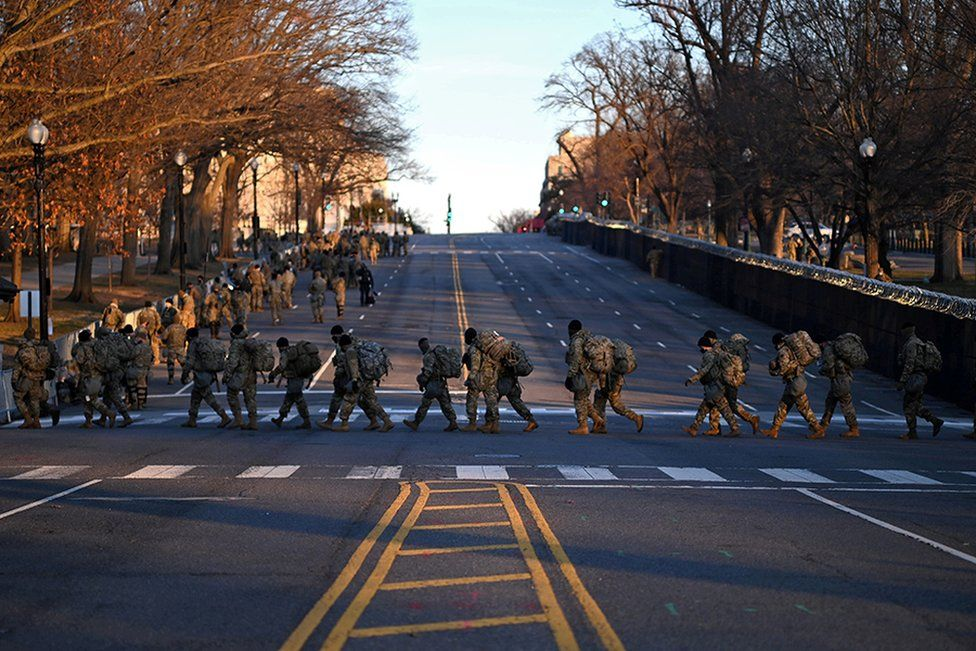 Troops prepare to exit the Capitol after the inauguration of Joe Biden as the 46th President of the United States, in Washington DC, 20 January 2021.