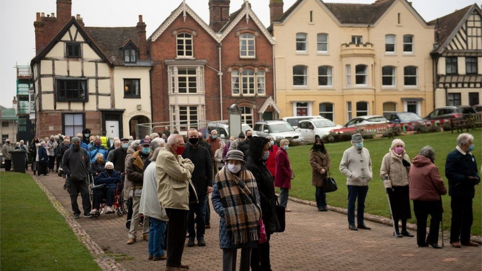 Members of the public queue outside Lichfield Cathedral,