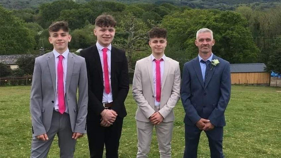 Chris Leeds and his three sons