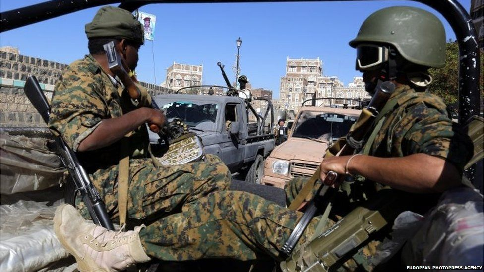 Newly recruited Houthi fighters ride vehicles during a gathering to mobilize more fighters to fight Saudi-backed Yemeni forces, in the old city of Sanaa