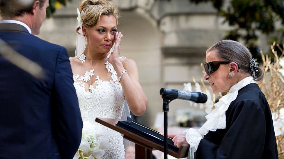 Alyson Cambridge wipes away a tear as Justice Ruth Bader Ginsburg officiates her wedding to Timothy Eloe in the garden of Anderson House in Washington DC, 30 May 2015