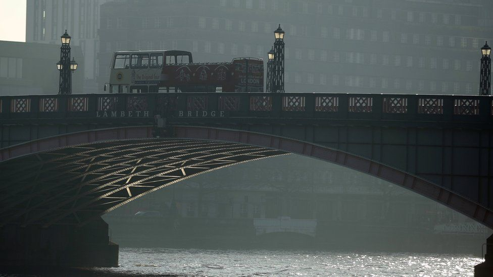 Buses on Lambeth Bridge with polluted air visible in the background
