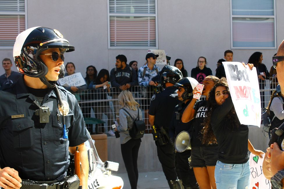 Police attend a protest on campus