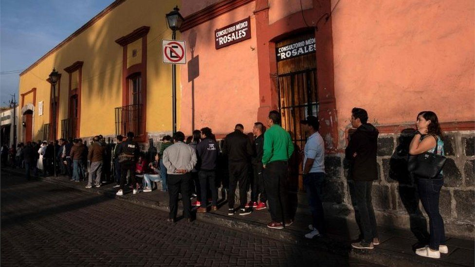 People queue to vote during the presidential election at a polling station in Xochimilco, Mexico City on July 1, 2018.