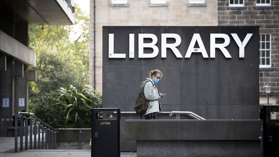 Student at university library