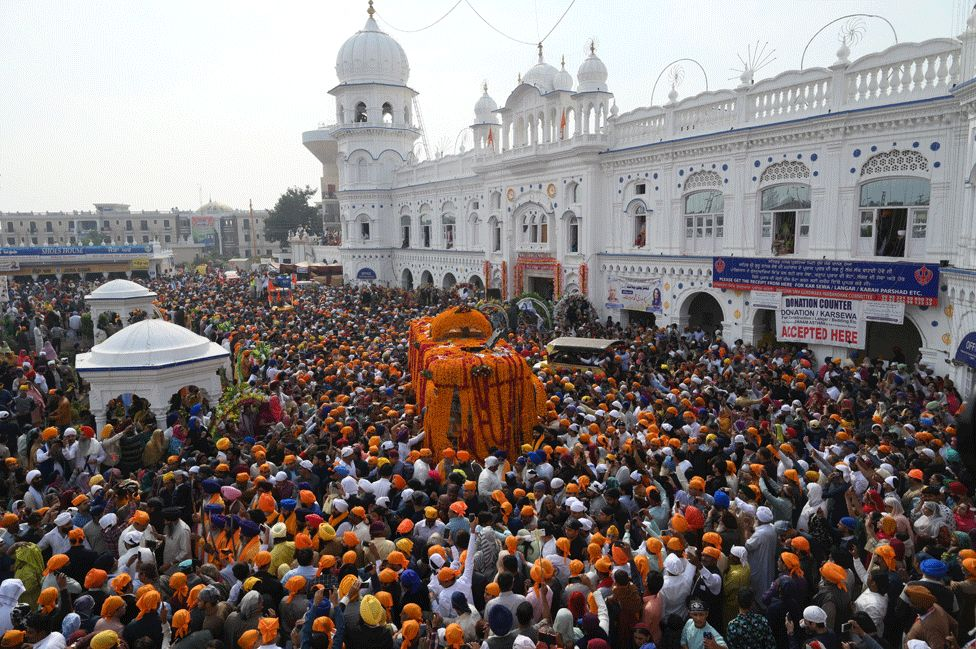 Sikh pilgrims take part in a religious ritual as they gather to celebrate the 550th birth anniversary of Guru Nanak Dev, at Nankana Sahib