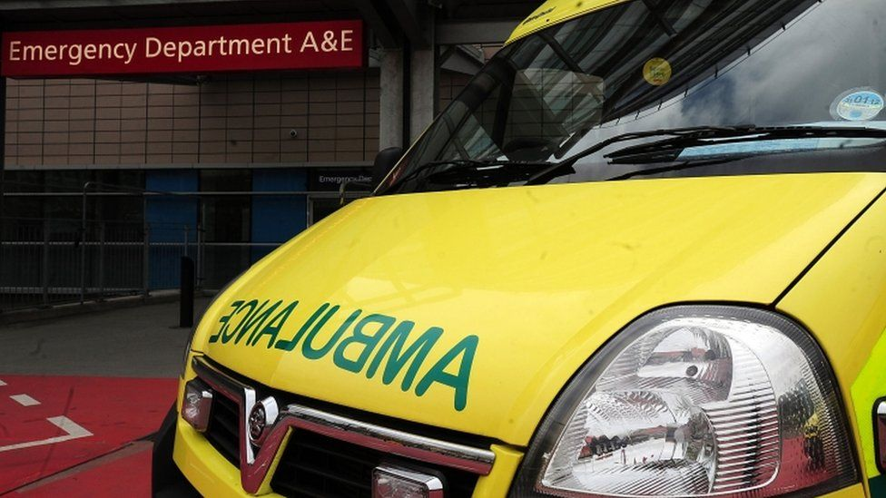 Close-up of a UK ambulance outside the entrance to a hospital Accident and Emergency department