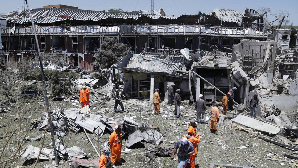Workers remove debris from a damaged area a day after a suicide bomb attack near foreign embassies in Kabul, Afghanistan, 01 June 2017
