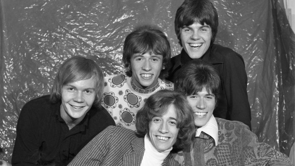 The Bee Gees backstage at Top of the Pops, sometime between 1967 and 1969. Back Row L- R: Colin Petersen; Maurice Gibb and Vince Melouney. Front Row L-R: Robin Gibb and Barry Gibb.