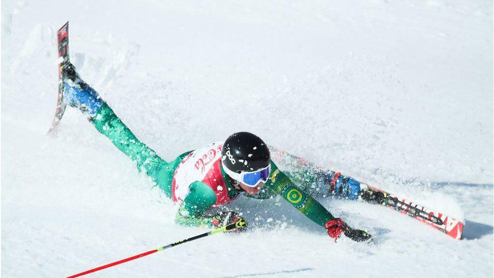 Jonty O'Callaghan of Australia falls over while skiing