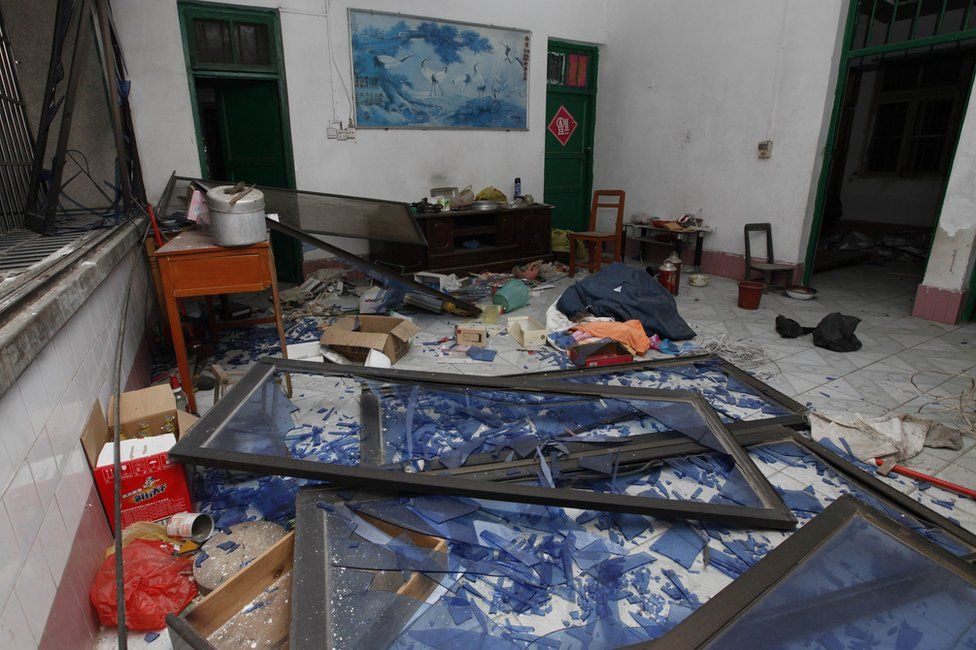 """Damaged windows are seen on the ground of a room at the site of blasts in Liucheng county in Liuzhou in south China""""s Guangxi province on 30 September 2015."""