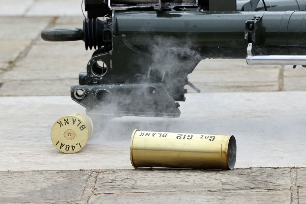 Used shells lie on the ground as The Honourable Artillery Company fire a gun salute at The Tower of London on April 10, 2021 in London