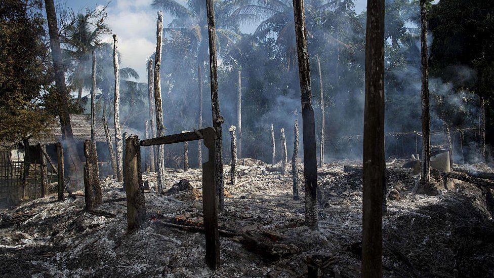 Smouldering debris of burned houses is seen in Warpait village, a Muslim village in Maungdaw located in Rakhine State on October 14, 2016