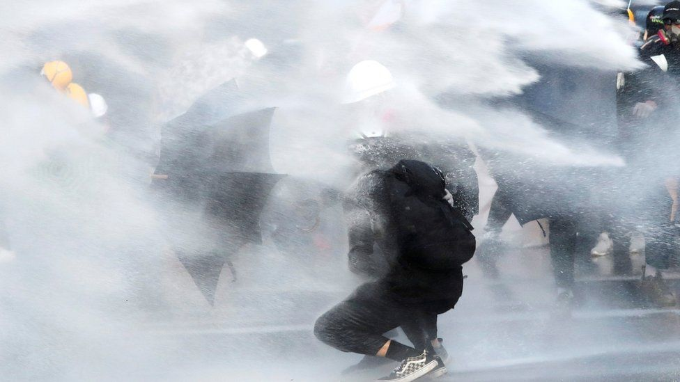 protester amid water cannon