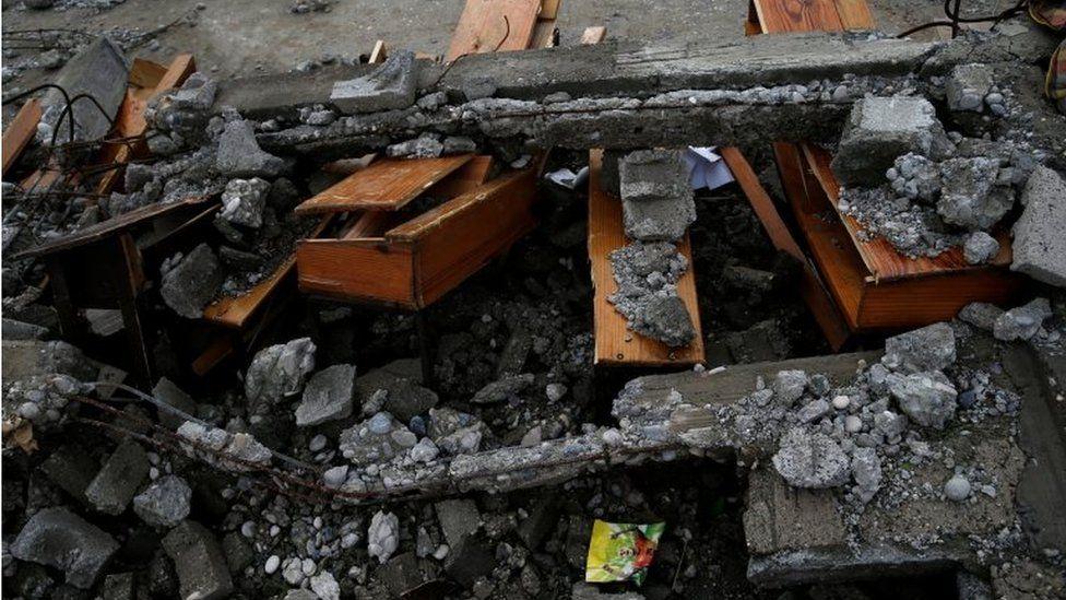 Destroyed desks are seen in a school after Hurricane Matthew passes Jeremie, Haiti, 5 October 2016.