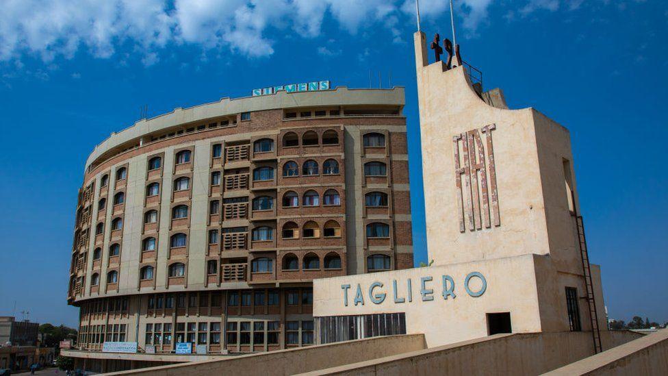 Futurist architecture of the FIAT tagliero service station built in 1938 in front of nakfa house, Central region, Asmara, Eritrea on August 22, 2019 in Asmara, Eritrea
