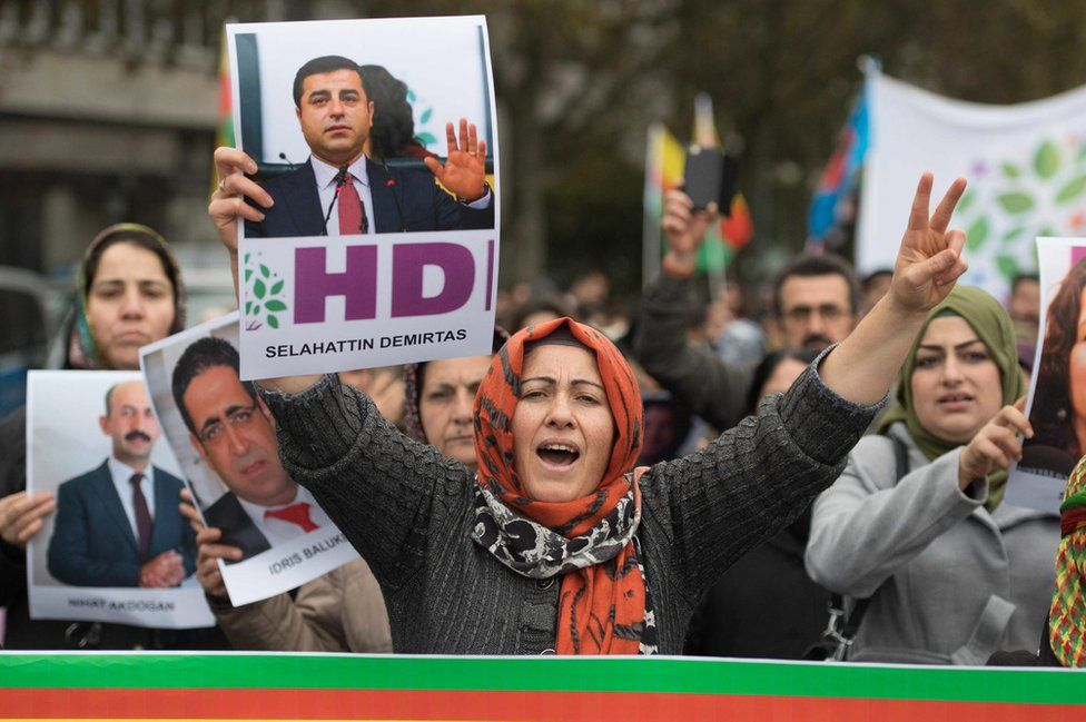 Kurdish demonstrators with banners protest against Turkish policies in Frankfurt am Main, Germany, on 4 November 2016.