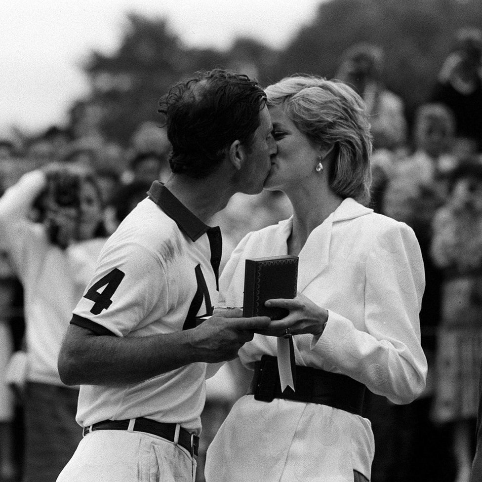 Princess of Wales presenting her husband, the Prince of Wales, with a prize and a kiss