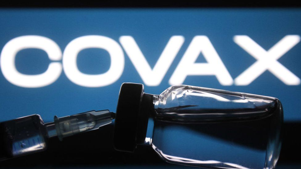 Covax logo with vial of vaccine