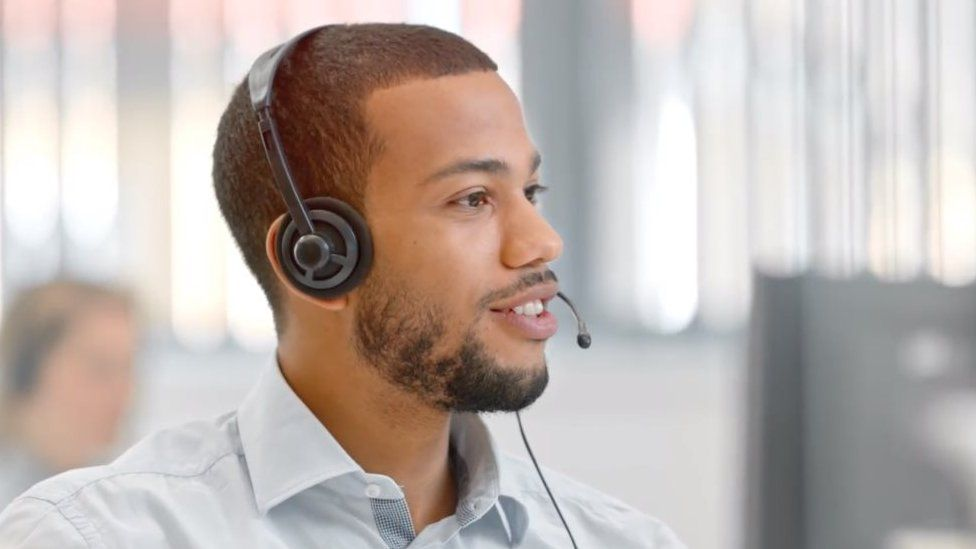 Call centre man talking on phone