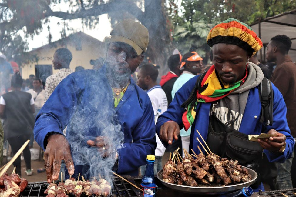 People grilling meat