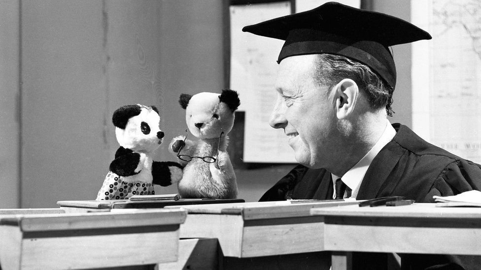 Sooty, Soo and Harry Corbett in a school scene in a BBC show in 1965