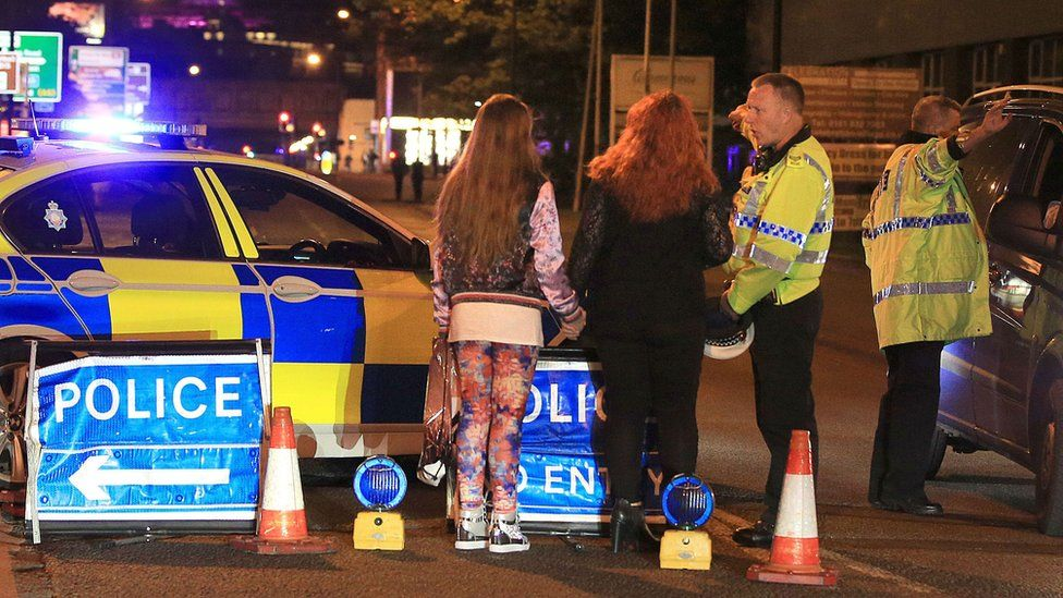 Police and concert-goers