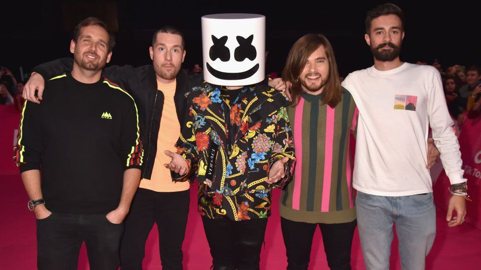 Members of Bastille with Marshmello