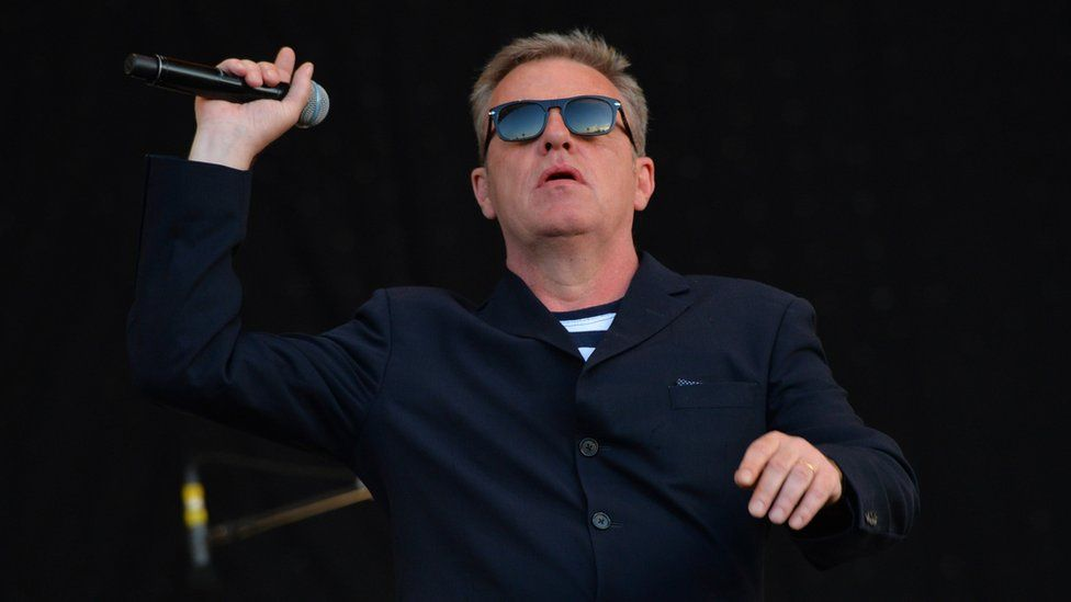 Suggs performing