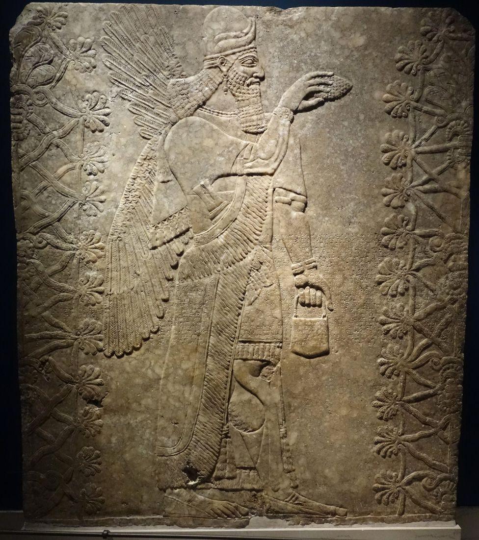 Genie of Nimrud, carved in stone