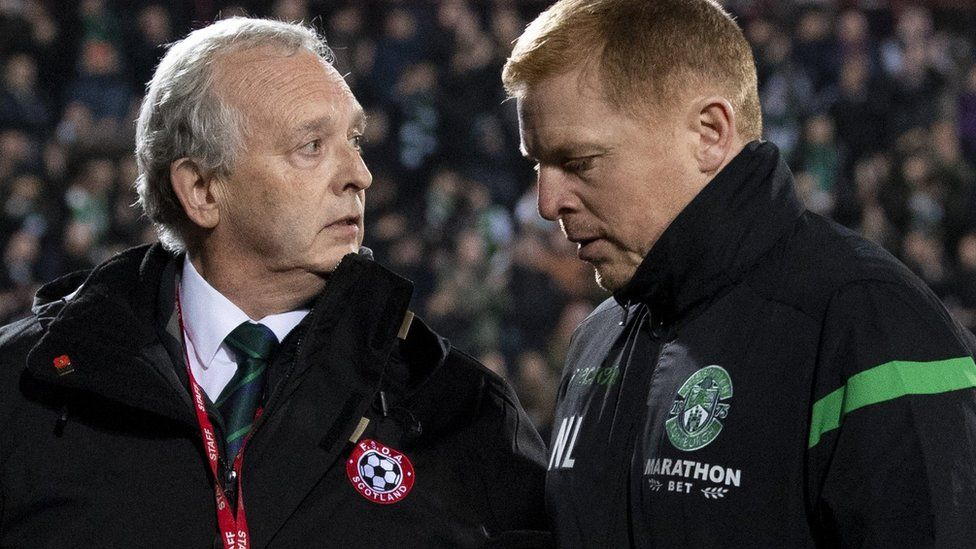 Hibernian manager Neil Lennon walks off the Tynecastle pitch at full time