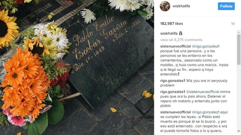 A screengrab from the Instagram account of Wiz Khalifa showing the grave of Pablo Escobar with flowers and a marijuana joint