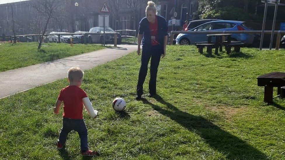 Archie practising his football skills outside Leeds Royal Infirmary