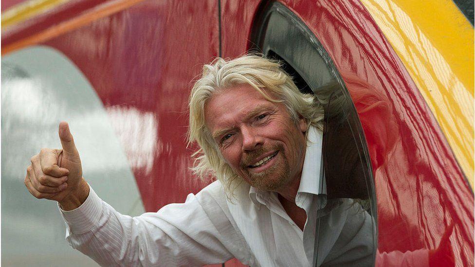 Richard Branson sticks his head out of a Virgin train window