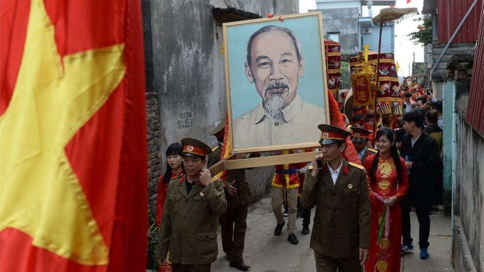 Veterans carry a portrait of Ho Chi Minh in a village procession in northern Vietnam (Feb 2015)