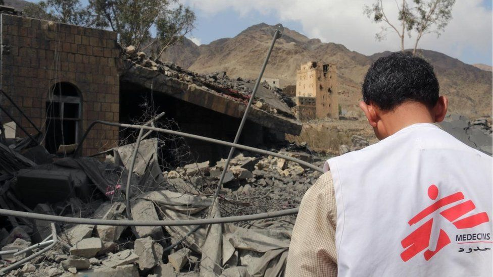A member of MSF's medical staff looks at the ruins of a hospital in Haydan, Yemen